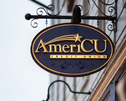 Photo of hanging AmeriCU building sign