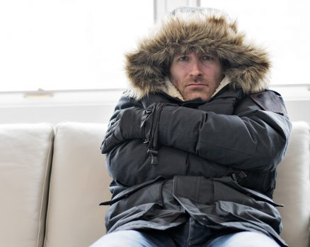 Man wearing winter coat inside