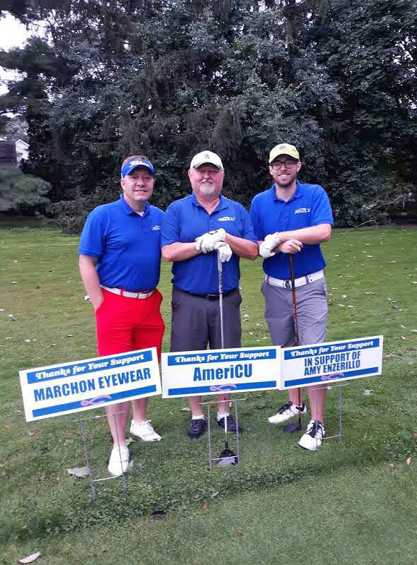 Photo of three men playing golf